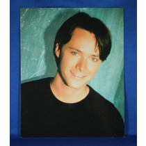 Bryan White - 8x10 color photograph on teal backdrop